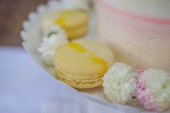lemon macarons dipped in white chocolate.